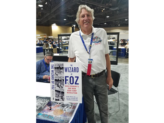 Olympian Dick Fosbury with his new book